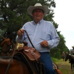 Tom Seay host of Best of America by Horseback TV Show riding at a leisurely early summer pace June 2013